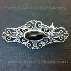 broche de filigrana de plata y azabache